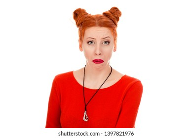 Closeup portrait of a beautiful displeased grumpy upset woman, frowning eyebrows, her look and grimace expressing annoyance and saddness  wearing red blouse standing posing on pure white background.