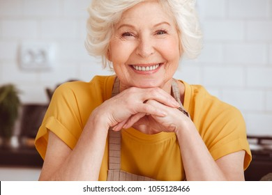 Closeup portrait beautiful elderly woman in the kitchen after cooking
