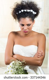 Closeup portrait of beautiful exotic emotional bride looking angry