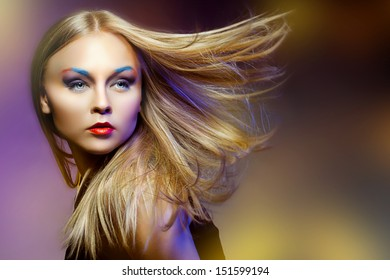 Close-up portrait of beautiful and fashion woman with Professional makeup and hairstyle i, studio shot