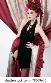 Closeup portrait of beautiful fashion woman posing with silck fabric.