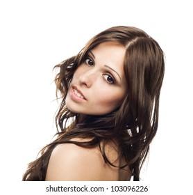 Closeup portrait of beautiful female model isolated on white background