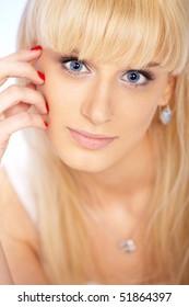 Closeup portrait of beautiful female model with blue eyes