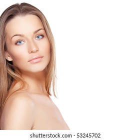 Closeup portrait of beautiful female model with blue eyes on white background