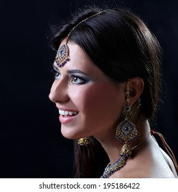 Closeup portrait of beautiful female wearing traditional indian