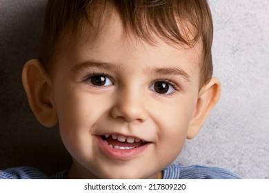 close-up portrait of a beautiful funny little boy