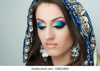 Closeup portrait of beautiful girl with colorful fashion makeup, Arabian style