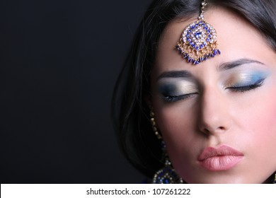 Closeup portrait of beautiful girl with eyes closed