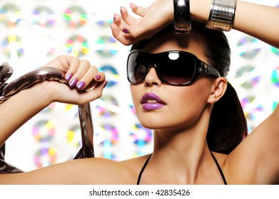 Close-up portrait of beautiful girl with glamour sunglasses on her face