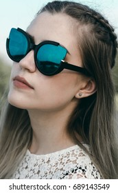 Close-up portrait of a beautiful girl with sunglasses. Fashion