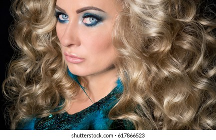 Closeup portrait of beautiful girl woman lady with volume combed hair styling. Luxury  curly hair