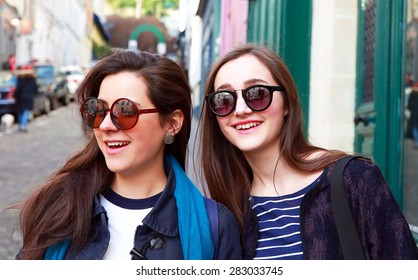 Close-up portrait of beautiful girls in the city