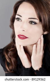 Closeup portrait of a beautiful green eyes red lips perfcet skin  woman looking away