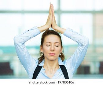 Closeup portrait beautiful hispanic businesswoman relaxing meditating eyes closed, indoors corporate building, office by doing some yoga isolated background windows. Positive emotion facial expression