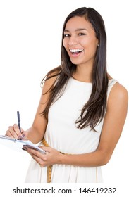 A close-up portrait of a beautiful laughing secretary or student, businesswoman holding a clipboard and a pen isolated on a white background.