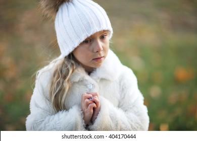 Closeup portrait of a beautiful little girl outdoors
