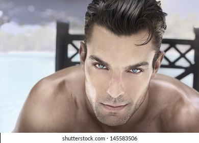 Closeup portrait of a beautiful male model with blue eyes and great hair