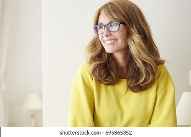 Close-up portrait of a beautiful middle aged woman laughing.