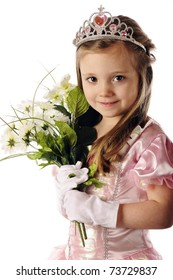 Closeup portrait of a beautiful preschool princes holding a bouquet of white flowers.  Isolated on white.