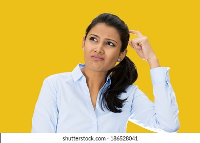 Closeup portrait, beautiful, pretty young woman thinking daydreaming trying to remember something, scratching head looking upwards, isolated yellow  background. Human facial expressions signs symbols