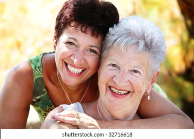 close-up portrait of a beautiful senior mother and daughter