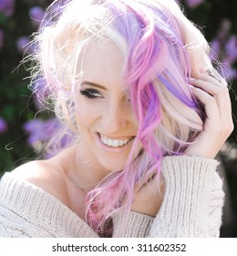close-up portrait of a beautiful sexy young blonde girl hipster with lilac and pink hair  posing