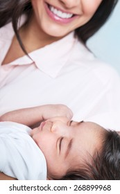 Closeup portrait of beautiful sleeping baby on mothers hands, enjoying motherhood, young happy family, love concept