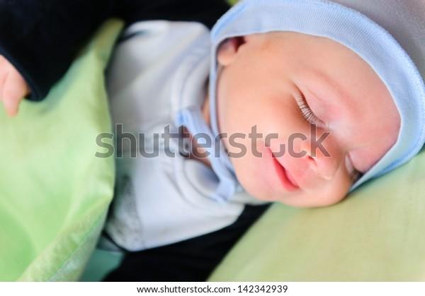 Closeup portrait of  beautiful sleeping newborn baby