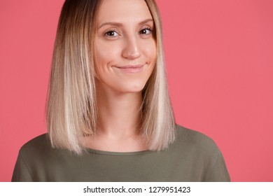 Close-up - portrait of a beautiful sly young blonde student on a bright pink background. Pretty woman found a solution to a long chronic cold. Copyspace