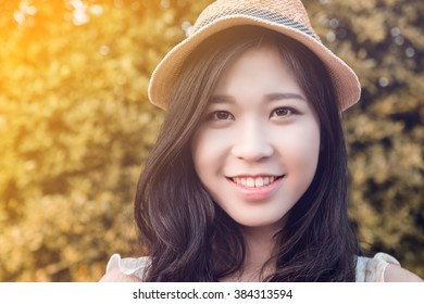 Closeup portrait of beautiful smiling asian girl, with knitted hat