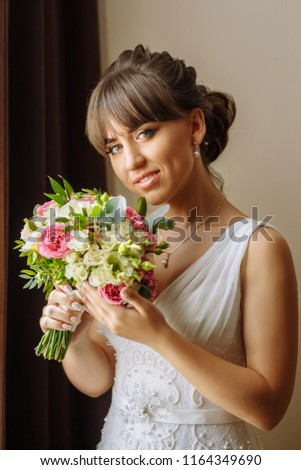 53bca61f089 closeup portrait of beautiful smiling bride in wedding white dress with  bouquet of flowers