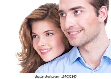 Closeup portrait of beautiful smiling couple isolated on white background. Attractive man and woman being playful.