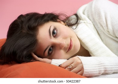 Closeup portrait of beautiful smiling woman on the bed