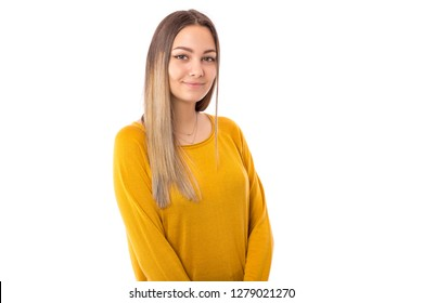 Closeup portrait of a beautiful teenage girl wearing yellow sweater posing over white background