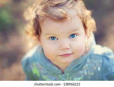 A Close-up Portrait of a Beautiful Toddler Girl