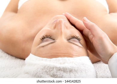 Closeup portrait of a beautiful woman after bath in massage
