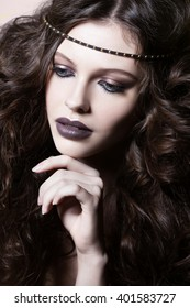 Close-up portrait of beautiful woman with bright make-up. Sensual Young Girl Posing