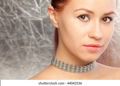 closeup portrait of the beautiful woman with choker