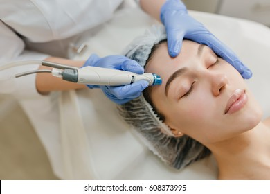 Closeup portrait of beautiful woman during cosmetology therapy in beauty salon. Professional dermatology procedures, lifting, rejuvenation, modern devices, healthcare