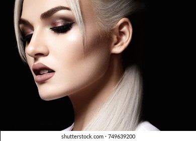 Closeup portrait with of beautiful woman face. Fashion makeup, clean shiny skin. Makeup and cosmetic. Beauty style on model face. Blond hair style
