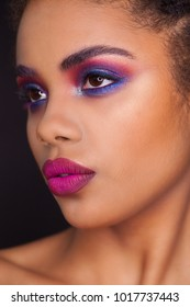 Closeup portrait of beautiful woman with fashion make-up