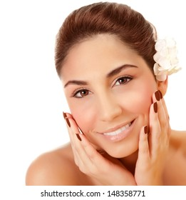 Closeup portrait of beautiful woman with fresh flower in head isolated on white background, enjoying day spa, skin care, health and beauty concept