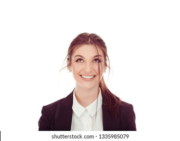 Closeup portrait of a beautiful woman looking upwards up to the copy space happy smiling girl wearing business wear, formal black suit, shirt cutout isolated on a pure white background. Look up here.
