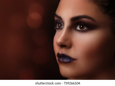 Close-up portrait of beautiful woman with make-up