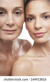 Closeup portrait of beautiful women of different ages on white background