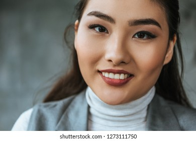 close-up portrait of beautiful young asian woman smiling at camera