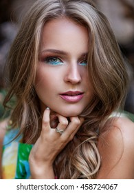 close-up portrait of beautiful young blond woman with fresh clean skin and sensual make up.