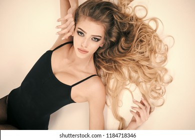 close-up portrait of a beautiful young blonde girl with long hair isolated on white background, lifestyle, posing