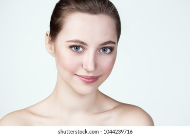 Close-up portrait of a beautiful young blue-eyed girl face