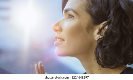 Close-up Portrait of the Beautiful Young Businesswoman Looking Thoughtfully out of Her Office Window. Confident and Attractive Hispanic Woman Thinking about Her Business Project.